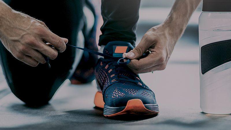 Circle Pines Gym Patron Tying Shoe